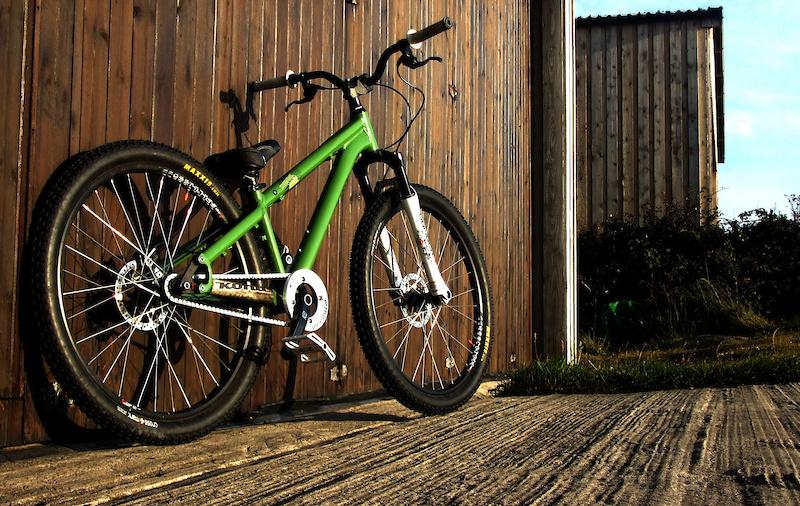 A freshly washed bike outside in the sun.