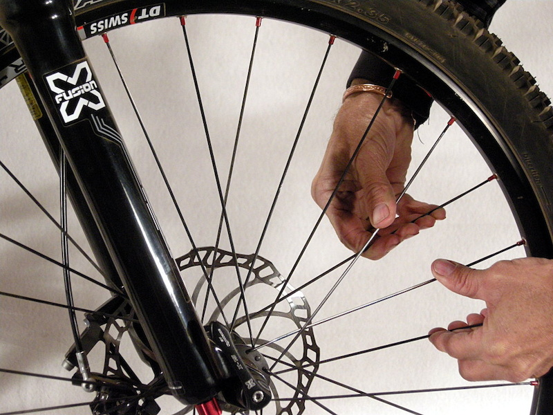 check spokes for tension