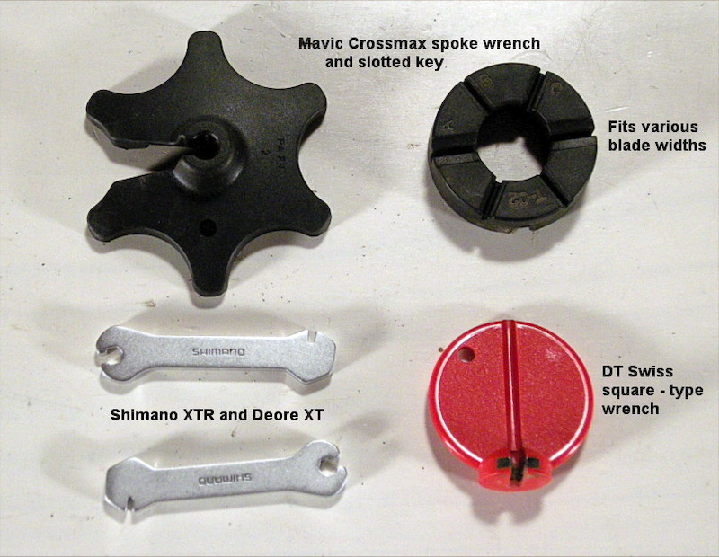 What You ll Need Proper spoke wrench. For standard square nipples choose the type that grabs three corners. Park and DT Swiss make the best. Some spokes use tiny hex nuts and others use splined nipples. - If your wheels have bladed spokes you ll need a second slotted tool that prevents the spoke from twisting as you tension the nipple. - Mavic top and Shimano lower left wheels are shipped with both a slotted and a splined spoke wrench. - Not shown but quite handy is a felt-tip pen to mark the apex of a wobble in the rim that needs straightening.