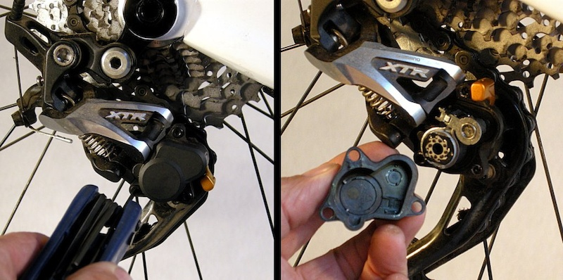 Remove the three clutch-housing screws. They are shoulder screws designed to bottom out on the aluminum derailleur chassis to protect the plastic housing. Put the housing and screws in a clean safe place.