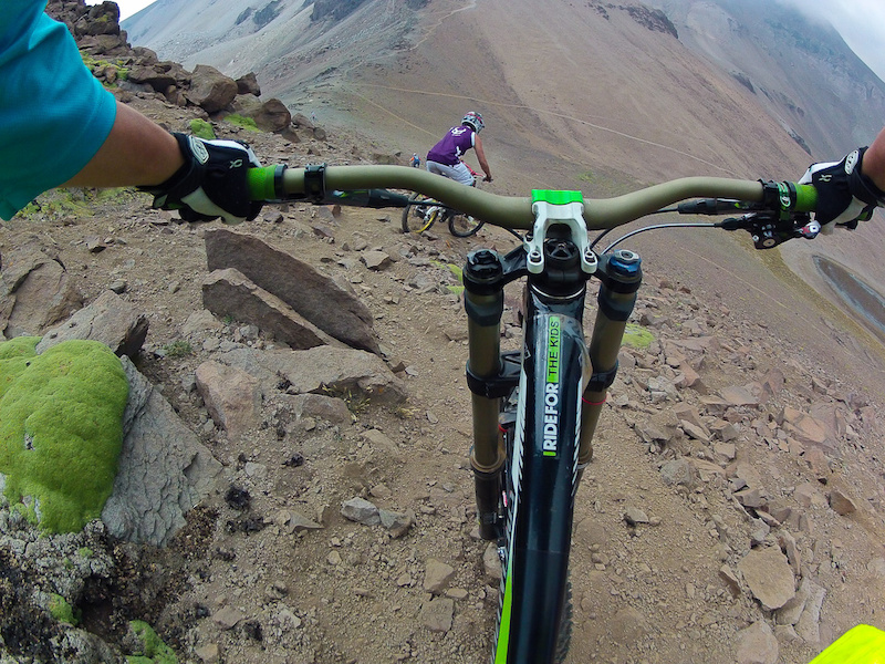 I follow Mikey Haderer and Chris Van Dine as we drop into a 10 500 descent towards Santiago over an hour away - downhill.