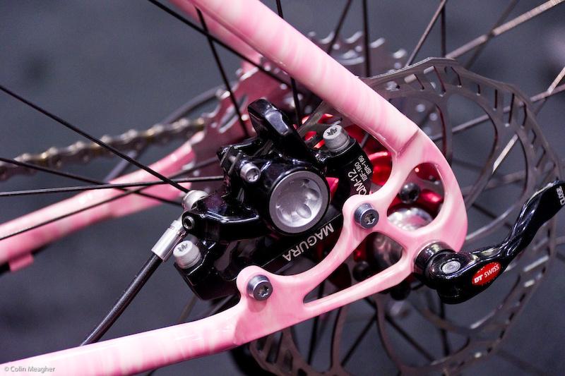 Rear brake caliper mount on the Groovy Pink Bike.