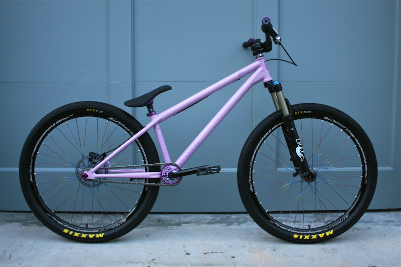 Frame Flat purple deity streetsweeper Fork 2010 Fox 831 non kashmia at 100mm Seat Purple deity tekstyle no bumpers Seatpost Black deity pyston Wheelset 2010 Atomlab superlight wheel set with titanium spokes. Crank Arms Deity vendetta 3 in black 170mm Spindle Deity 153mm ti Sprocket purple deity termite Bb Deity spanish armada in purple 19m Chain KMC 710 SL in chrome Pedals Premium Slim PC in black Valve caps Deity crown in purple Seat clamp Deity Cinch in purple Bars Deity topsoil in black Brake 2010 Shimano Xt with a 160mm Avid Cleansweep G3 Stem Thomson x4 elite in black Grips Deity enkoi with purple collars Headset Odyssey zero stack integrated in black Tires Maxxis DTH 2.15 kevlar with giant maxxis logo Tubes Maxxis Ultra light Schrade valve.