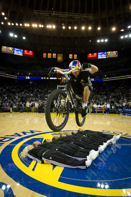 Kenny Balaey performs on his bike at the Oracle Arena in Oakland California during the halftime of the Golden State Warriors VS. Boston Celtic NBA teams.