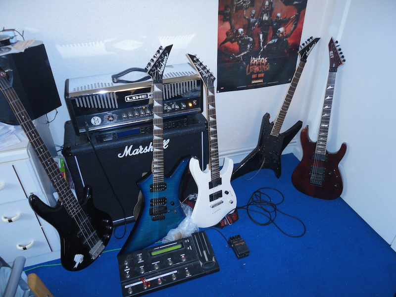 Mainly Jacksons - pic is missing red black Jackson V and bass isn t mine. Line6 HD147 amp TC Electronics GMajor