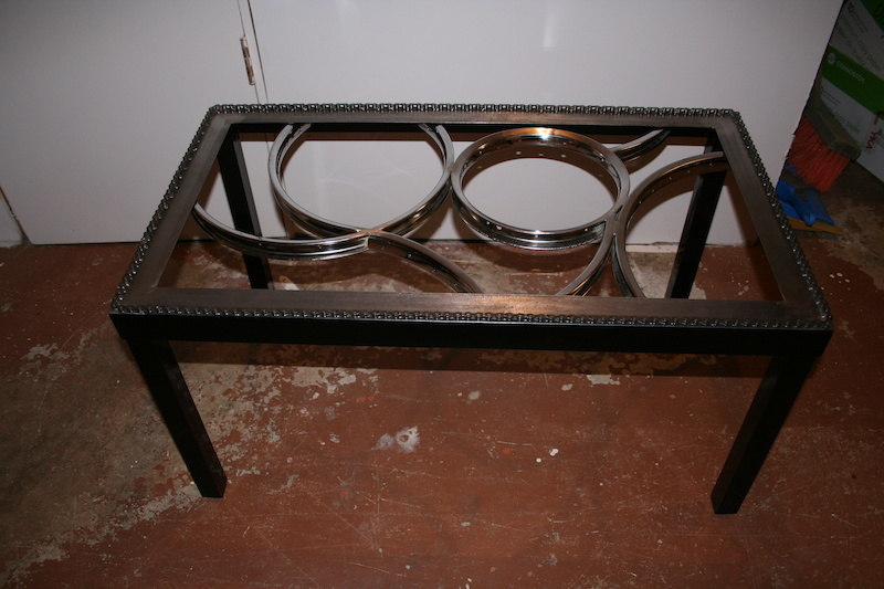 A coffee table I made using old steel bike rims.  No glass in it yet
