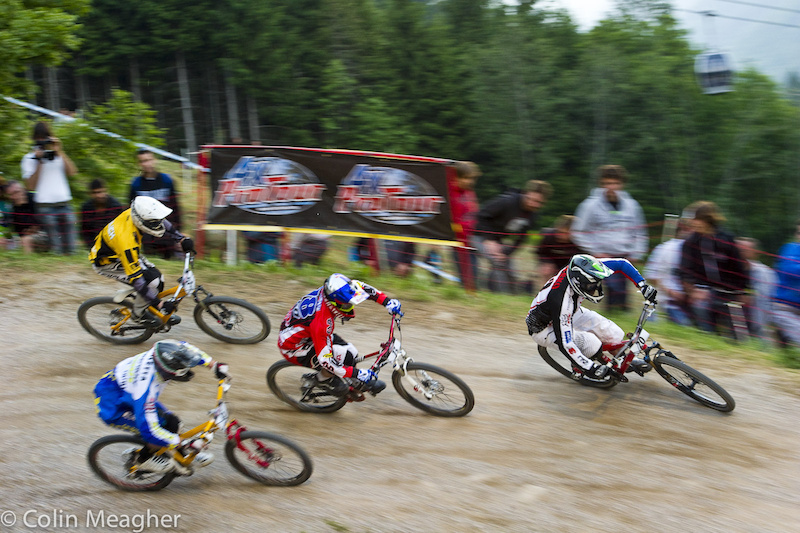 Marek Pesko leading the bunch into the first turn at Val di Sole during the first round of 4X racing.