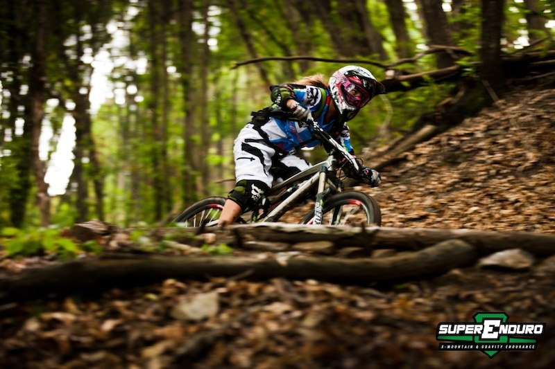 Isabeau Courdurier team Massilia Bike on the last stage of the Superenduro round3 in Pogno just before the victory in the female category