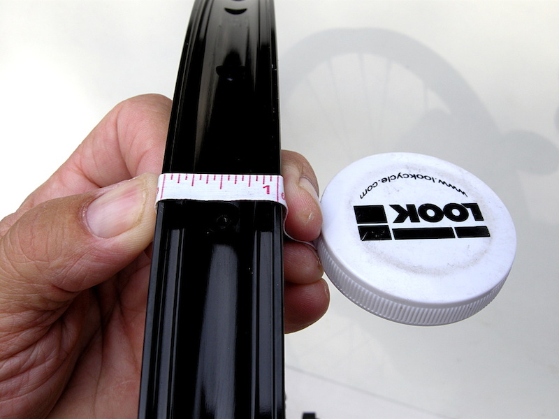 Measure the width of the rim outside to outside. This is how wide your sealing tape will need to be sized in order to span the ID of the rim surface and seal correctly.