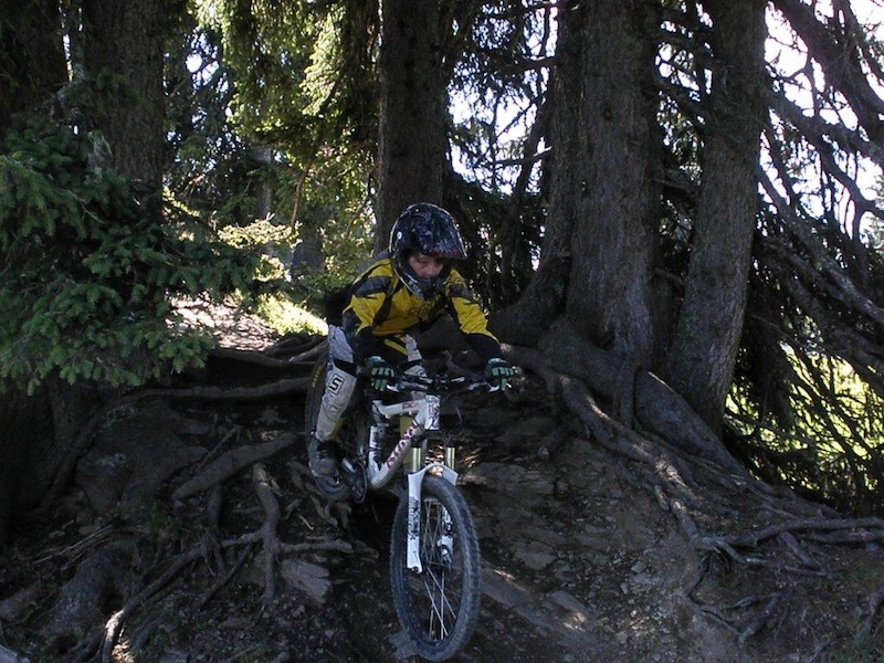 Rookie Freeride Camp Mastering difficult roots in the wooden section of the Hangman I trail.