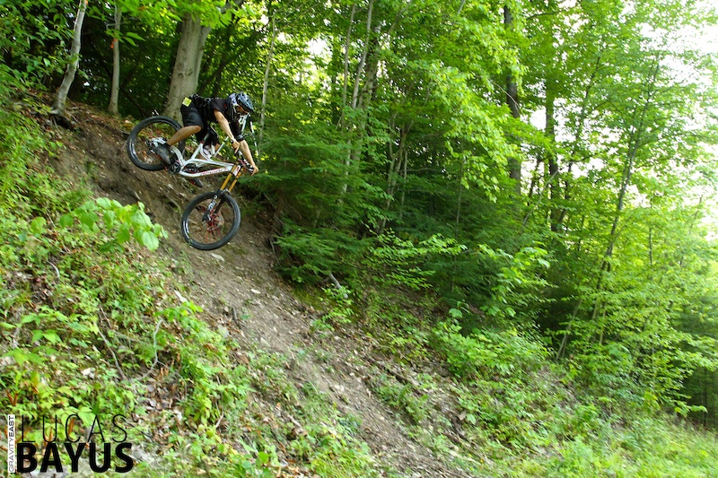 Come flying out of the woods onto the fire road below for a left hand drift-tastic turn. Don t let the photos deceive you... a little too much pop off the top could send you right to the bottom.