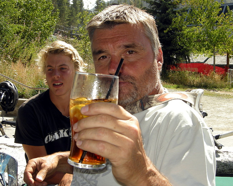 Lift your glass for this man. Tom Pro Prochazka takes a break with trail-builder Jesse Sanders. Tom Pro first managed the Whistler bike park and was instrumental in developing the trail system. Tom now heads Gravity Logic - the most respected trail design firm in the world.