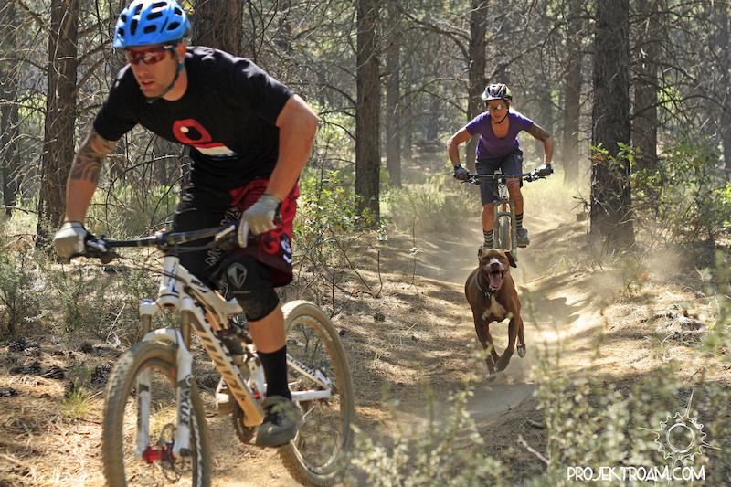 Dennis and Carolynn and there dog shredding Whoops trail in Bend OR.