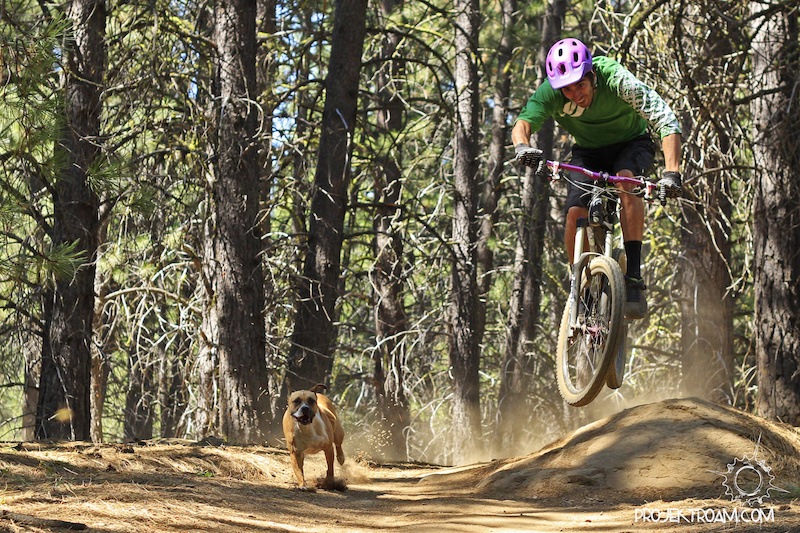 Colt with a dumb look on his face shredding with his dog on the Whoops trail in Bend OR.