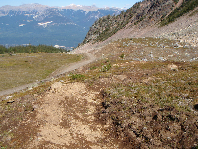 In early summer the treacherous 10Rd is the only route through the alpine until the snow melts. Well we figured out what melts first and just built a trail there. Enjoy it next July.