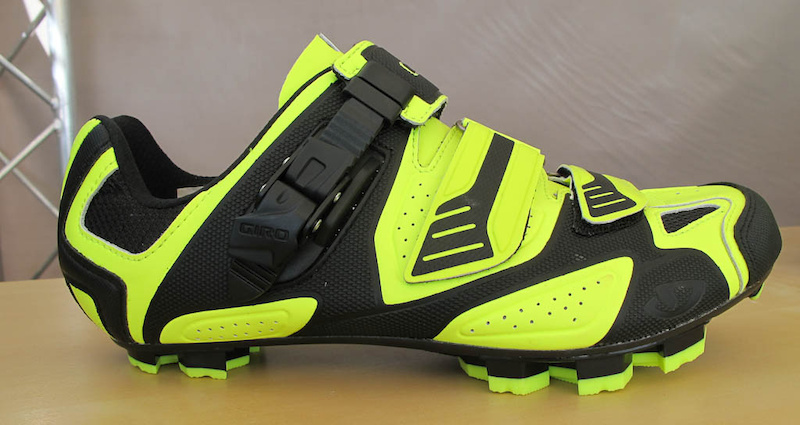The Giro Code shoe caught my eye because of its High Vis colors once I asked more about the shoes I learned that it s Giro s high end XC shoe featuring an EC90 carbon shank three strap closure toe spikes and rubber soles and retails for 290 USD