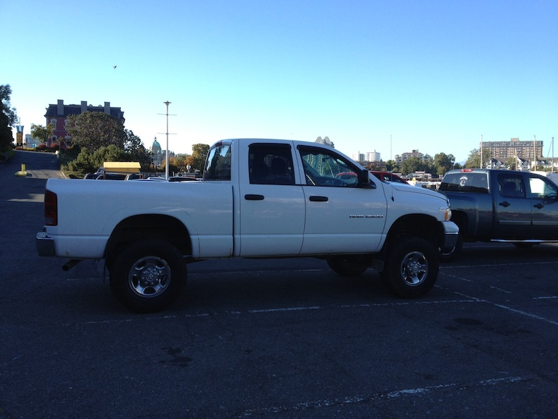 2005 dodge ram 2500 with 6 fabtech lift full flowmaster and 35 tires.