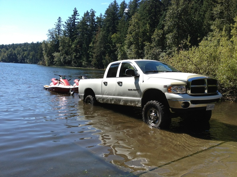 2005 dodge ram 2500 with 6 fabtech lift full flomaster and 35 tires. dual 2000 tigershark 770cc twin 2 strokes.