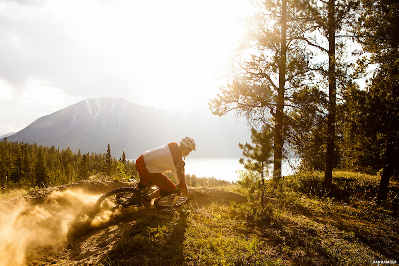 Sam Reimer kicks up a cloud of dust while cornering his mountain bike in Carcross Yukon Canada