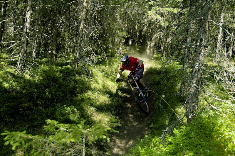 Riding the lower section of the Nine Knights Trail on Wildkogel. Neukirchen