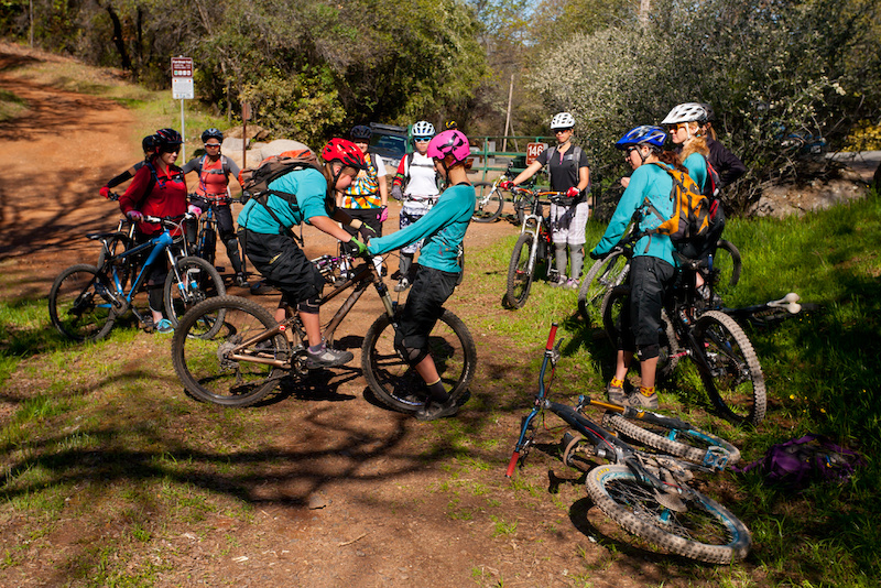 TEAM in action IMIC coach Lindsay Beth Currier is joined by the other four members of the Shine Gravity Race Team at the first team fundraiser of the season. Special thanks to Auburn Bike Company for making it happen.