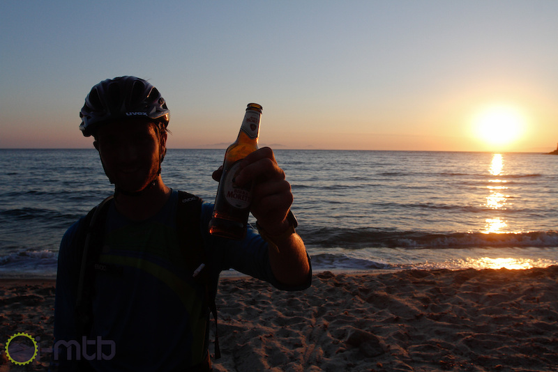 Max Schuman one of the fastest German Enduro riders enjoys a beer on the beach.