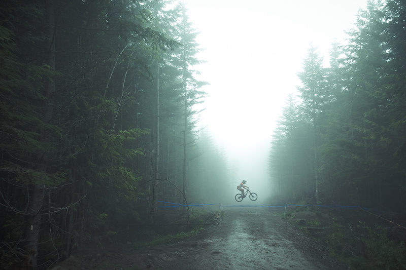 An unknown rider gaps the road in the mist on day two of the third Northwest Cup.