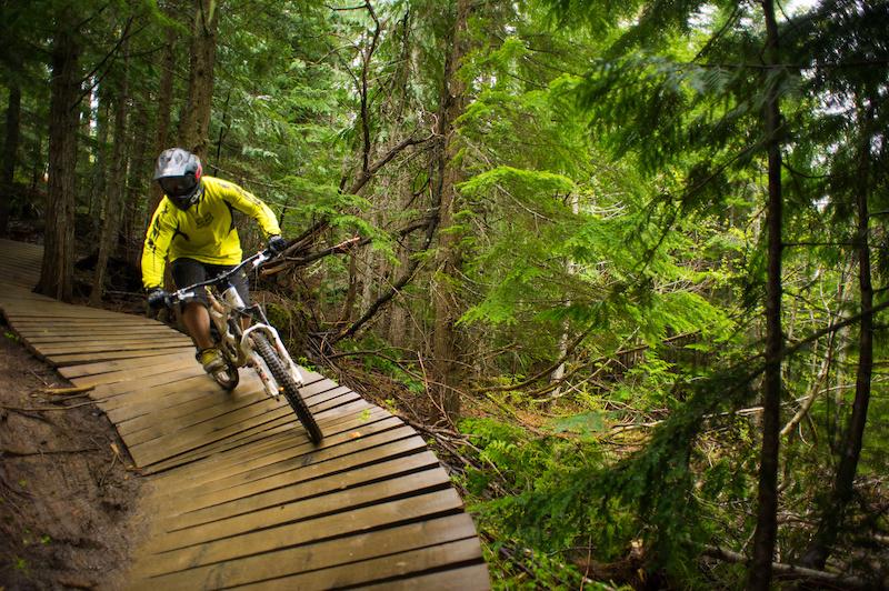 Biking in the whistler Bike Park. Tourism Whistler Mike Crane