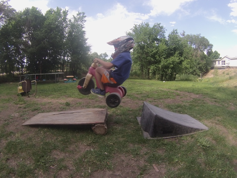 This is a nice snapshot of me flying off of the new gap jump I built. It s not much but it s a lot on a trike.