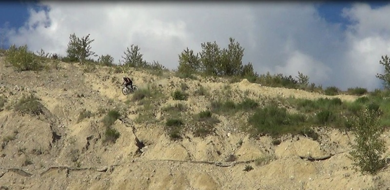 Saw this slope behind a gas station in Golden had to hit it but it was near unrideable with rock hard dirt and pebbles.