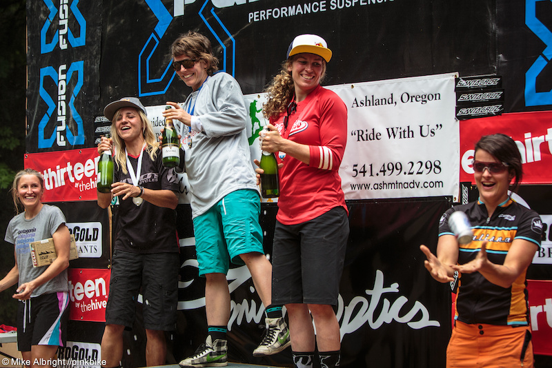 The top 3 (Carolynn, Rosara, Jill) wait while Abby (right) gets the now-customary beer in a can for 'the rest' of the podium.