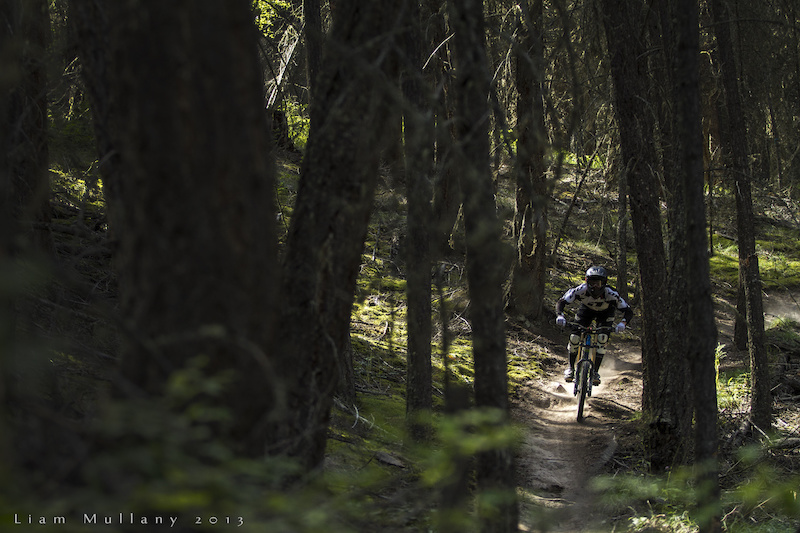 Kirk pounding through a pocket of late afternoon sunshine on the fast and loose trails on Harper Mountain for his episode of Over the Edge.