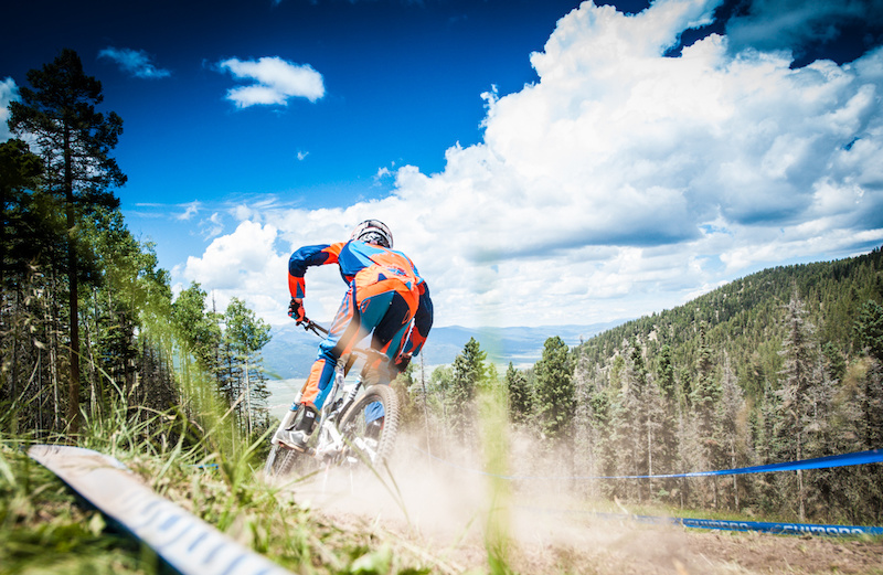 Burney traversing open slope at Angel Fire. Thunder storms kept the dirt in the woods tacky in qualies but the open track bits quickly turned back into loose dust.