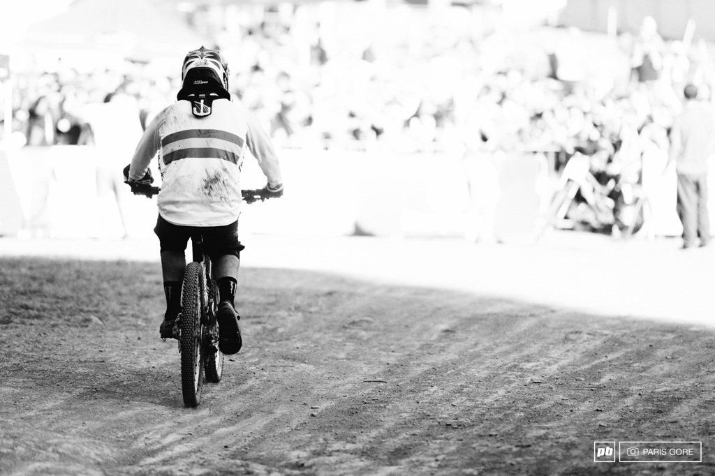 Sam Hill took a brutal crash and is lucky to be rolling down the finish on two wheels.