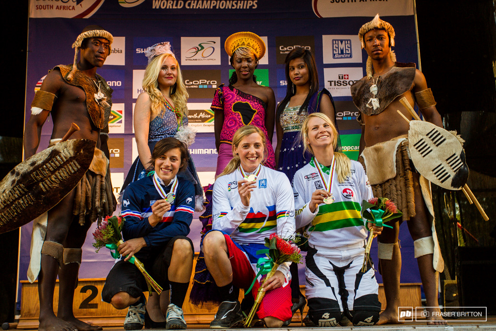 3 very happy ladies on the women s podium flanked by their local bodyguards.