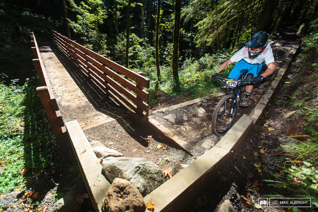 Anyone who has ridden Two Turntables and a Microwave at Sandy Ridge will remember this bridge section. Fun to ride but more difficult to race when you are trying to hit these tight corners at full speed. Joe Buckley showing how it s done.