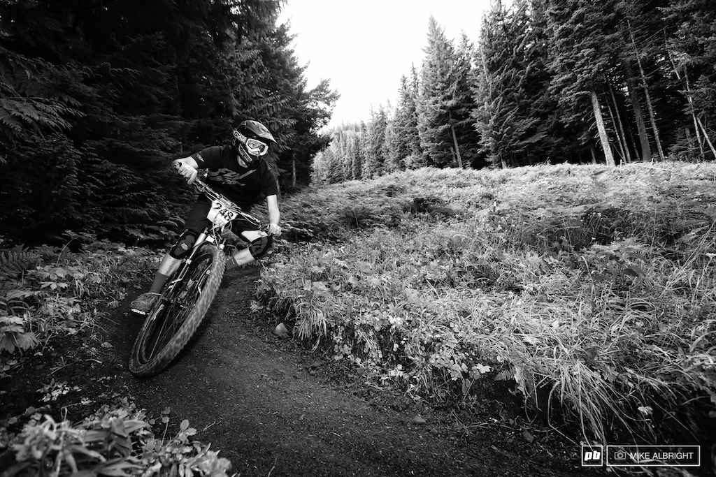 Craig Parker enjoying the final stage of the 2013 Oregon Enduro Series race. This section has been used for DH races from 20 years at Ski Bowl. It s not super technical as it winds back and forth between tree lines but it is possible to wash out in a corner and lose time.