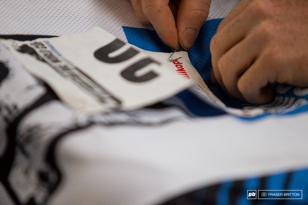 Joe Smith gets his back number ready to go while working through the pre race jitters.