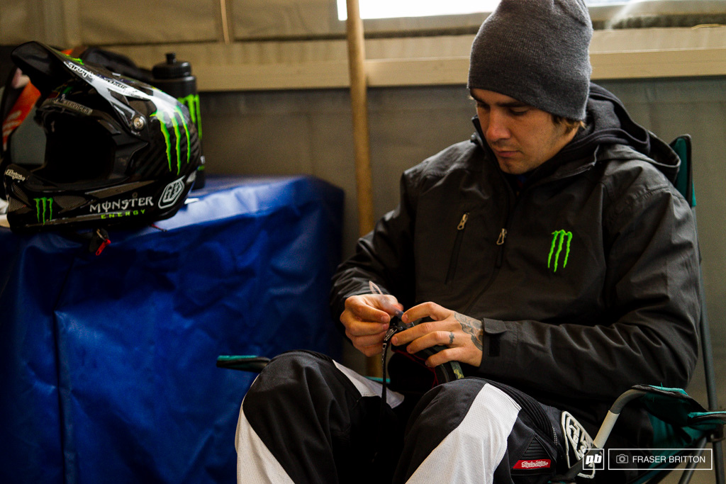 Sam Hill preps his goggles for a very wet race here in Hafjell.