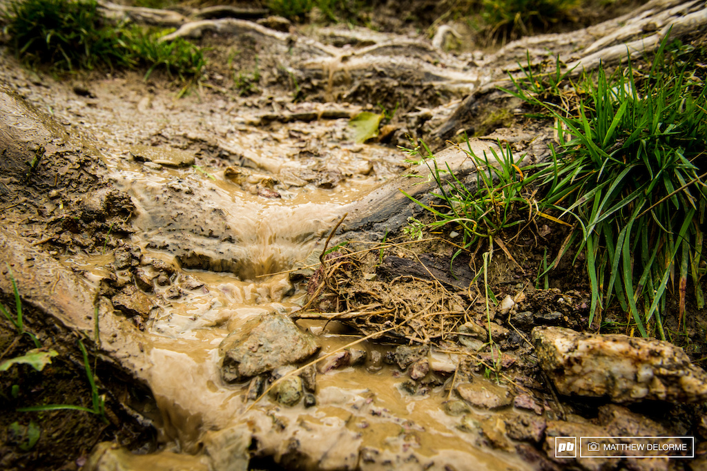 A river runs through it. Three days of heavy rains, and even some snow, have turned parts of the track into a stream.