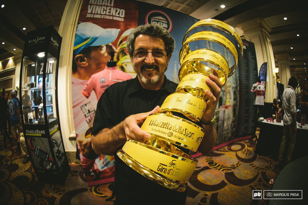 PB s Richard Cunningham holds up the real Giro d Italia Cup which was on open display at the front entrance to the indoor show. That s mountain biking s equivalent to walking into a hockey arena grabbing the Stanley Cup off a not-so-well-gaurded table and hoisting it in the air for all your friends to make you Instagram famous.