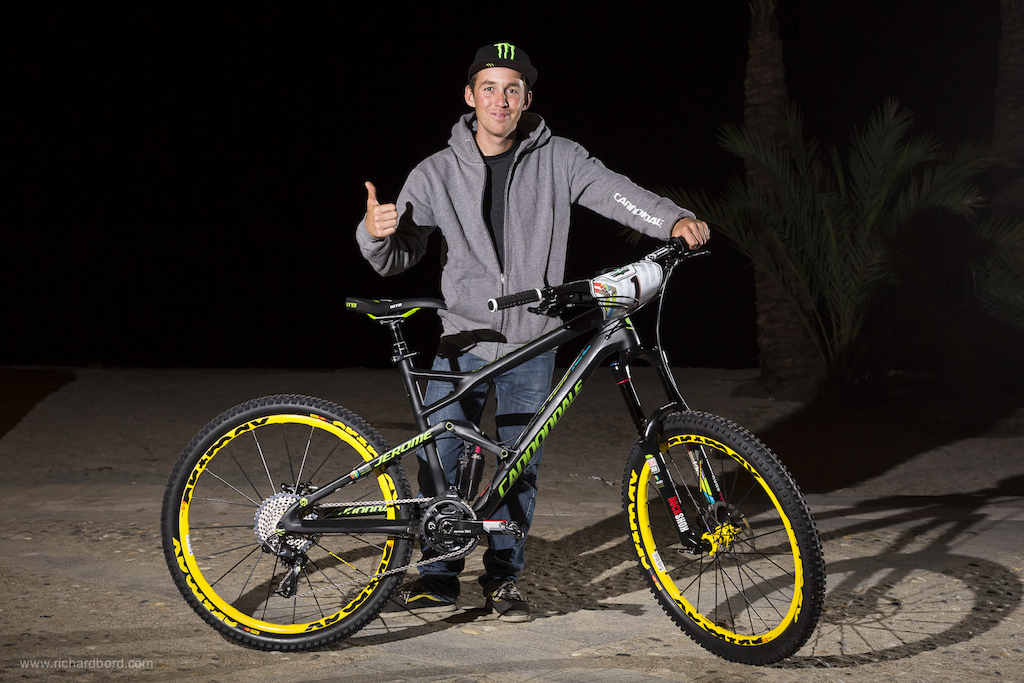 Jerome Clementz poses with his brand new special race bike a Cannondale Jekyll full painted in a black mat with special stickers. Jey Clements Number 1