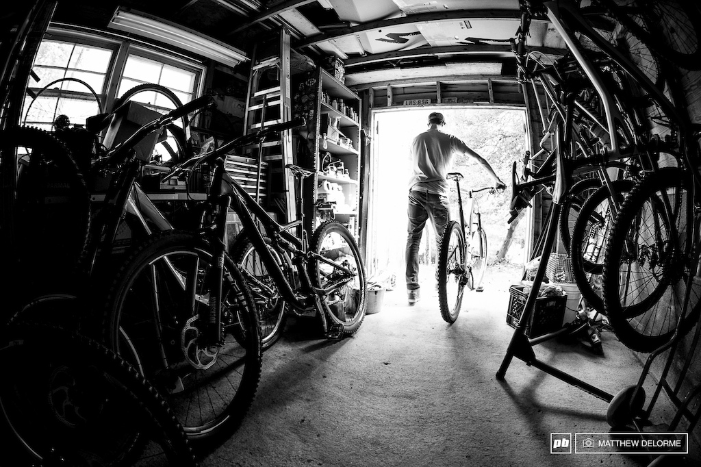 The inner sanctum. So many bikes in the stable. Walker picks his weapon of choice for the day s training ride.