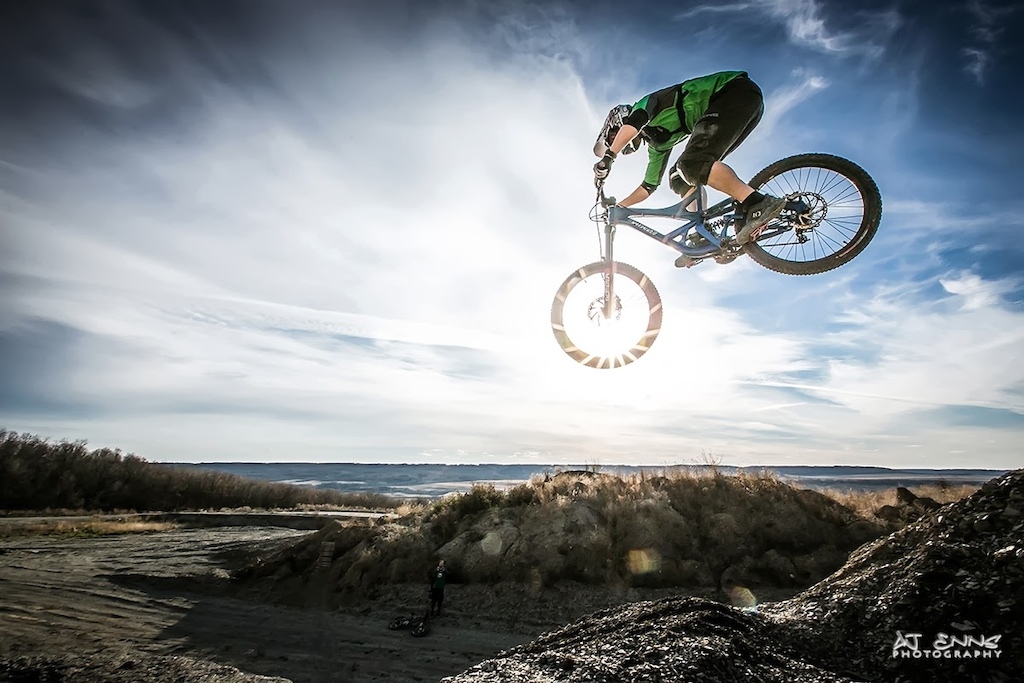 Doing a 15' gap while catching the sun in his front wheel