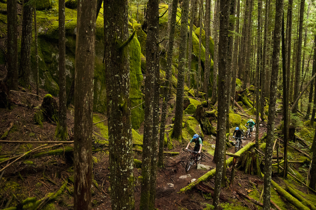 We stopped for a bit of lunch at the Living Room Restaurant in Squamish before heading out for one of Roland s Go-to after work loops. I could see why it s perfect for him since we were hitting the dirt only minutes from his house. Dre has spent a lot of time riding in Squamish between being a veteran of the Test of Metal and hosting the BC Bike Race on Squamish s finest trails. He seemed super fired up to ride so that is a testament to the longevity and worthiness of this town at the Head of Howe Sound After my three days of learning more of Squamish s trails back in August I have thought of them often. I d say Squamish might have the strongest network of mountain bike trails anywhere. Especially when you look at them from the perspective of being really user friendly and accessible to the public. In this shot we are on a particularly tricky side-hill section of Entrails which has lots of pedal grabber rocks and a couple semi awkward short little up and overs. Roland gave me an important tip about the first tough tight spot which almost didn t appear to have enough room to make it through but surprise surprise worked perfectly. We paused for a bit at Edith Lake which is the site of an old logging camp. We were talking about our bucket list for places in the world we want to ride. Dre had this to say For me there are so many places and events on my bucket list and time is so precious these days with two young kids. Switzerland on the Big Mountain Cloudraker trip Madagascar and the Reunion Islands for the Mega China Nepal anywhere there are high mountains and wicked trails back to the Chilcotins Northern BC and Sun Valley Idaho to name just a very few. Currently Rocky is working on a video project with Mountain Bike Tourism BC this has allowed me to travel extensively around the province. There are so many amazing places and we are only half way through the project with a whole year yet to go - ask me that again at the end of the year and I ll be able to say I ve been all over the province. However I m pretty sure I will still only have scratched the surface