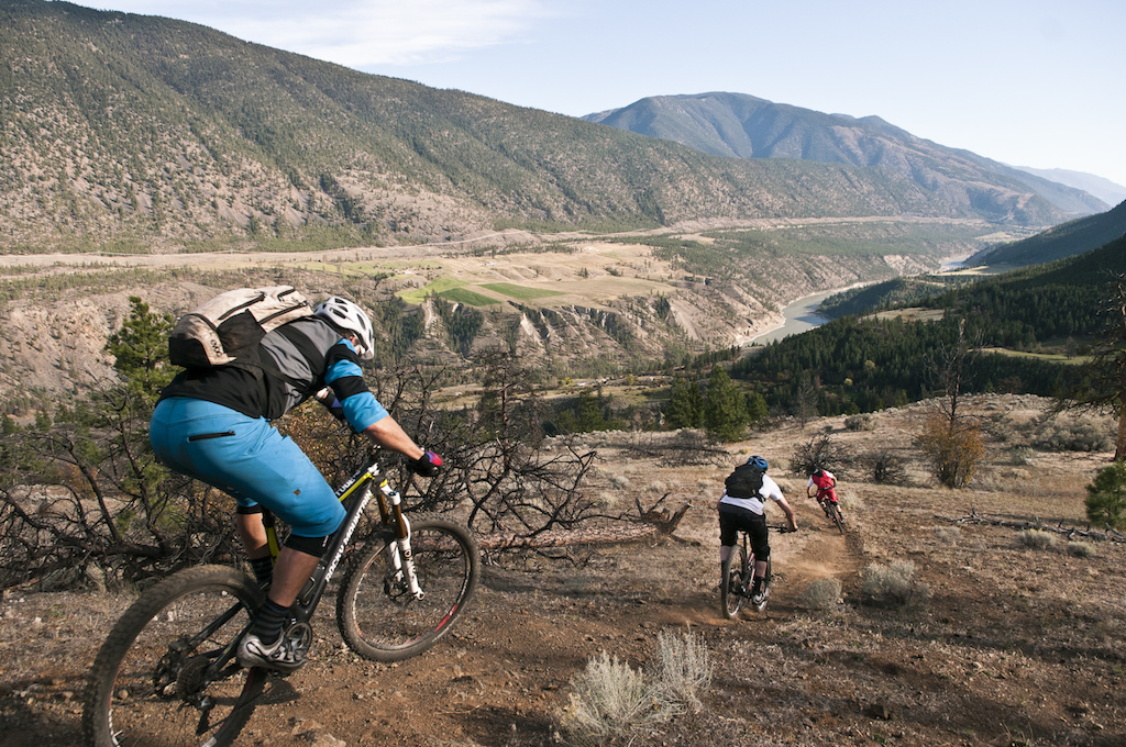 Riding Della Creek with Matt Dre Kari and Connor was some of the only dry desert style riding I d done all year. It was beyond fun. We barely clung to the edge of the mountain our traction tenuous in the loose soil. We crushed steep sections. We pulverised corners. Matt engaged his nasal diffusers . Dre rode with his elbows out his pedal strokes churning his tires into the ground. Due to various clunks Kari decided that he needed a new bike soon but regardless rode like a champ as always. Connor blew by us at mach velocity and veered off the trail to absolutely detonate a pile of pine needles into high flying shrapnel. We hit jumps that sent us shooting down the mountainside landing on the narrow trail in a rush of wind. In the distance far below we saw wild horses from afar. The sky was wide open the river long and bendy. We were experiencing the last moments of riding our bikes on an expedition that had taken us through many diverse zones and down different trails. Our journey through these changing landscapes served as a metaphor to Andreas Hestler s voyage through the years as a Trail Blazer. He has been an ambassador to an entire generation of mountain bikers and continues to inspire. There doesn t seem to be any chance his fire will go out.
