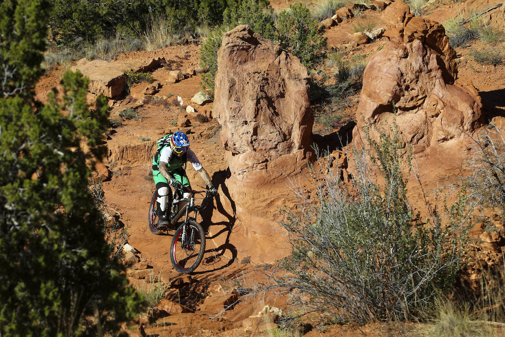 After we paid for the entry to Red Mesa Gaspi tried to ride some local snail trails.