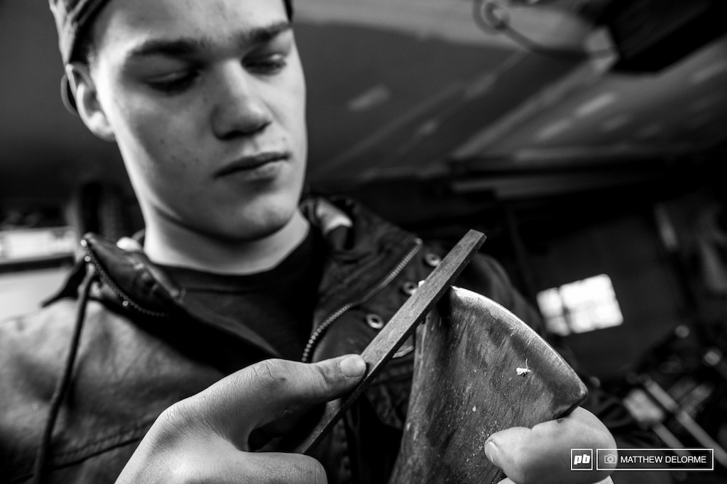 It takes more than brute force to split wood. Keeping the axe sharp is all part of the ritual.