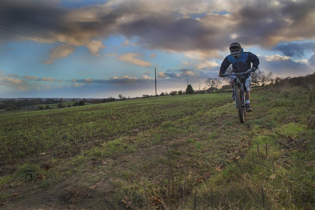 Self-portrait of myself riding through the fields near Duffield, UK.