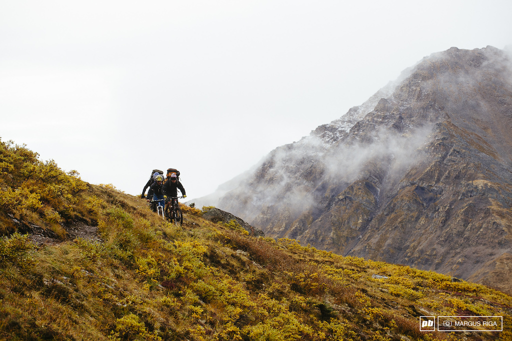 Kenny Smith James Doerfling and Riley McIntosh making their way to the Tombstone mountains Yukon. Kenny s excuse for not wearing a helmet I can either be warm or protected just in case I fall. I choose to be warm because I m not going to fall. Again BMF
